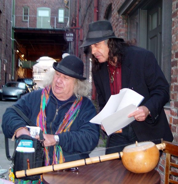 2004. Spencer Dryden Benefit at Slims: San Francisco: 5/22/04 Benefit organizer Pete Sears goes over the evenings schedule with master of ceremonies Wavy Gravy.